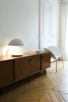 Credenza. Light fixture. Hardwood flooring. Photo by Daniel Hertzell.