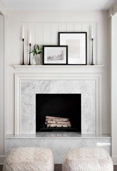 This fireplace is one of my favorite features of the Sandvalls' home. The crisp, clean lines of the monochromatic texture combined with the coffered ceiling creates a traditional look that I love. This marble hearth also incorporates a modern detail that makes the space feel very polished.