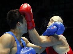 Iran's Ehsan Rouzbahani fights with Kazakhstan's Adilbek Niyazymbetov in their men's light heavy semi-final boxing match at the Seonhak Gymnasium during the 2014 Asian Games in Incheon October 2, 2014. REUTERS-Kim Kyung-Hoon