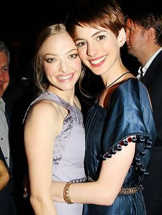 There's nothing but love between Amanda Seyfried and Anne Hathaway, who share a sweet embrace at an N.Y.C. screening of their new film, Les Misérables, Sunday