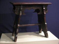 AN UNUSUAL EARLY  17TH CENTURY OAK BOARDED STOOL. ENGLISH .CIRCA 1600.