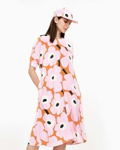 The A-line Vokaali dress is made of viscose crepe and decorated with the fresh Unikko pattern in pink, orange and green. The dress has a round neckline, a concealed zipper in the back seam, side seam pockets and short kimono sleeves with elastic band gath Marimekko Dress, Short Kimono, African Textiles, Scandinavian Style, Pattern Fashion, Pink Dress, Dress Skirt, High Neck Dress, Short Sleeve Dresses