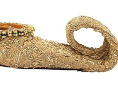The curly- toed golden-threaded shoes of a Nizam of Hyderabad  These days, you can pay a cool US3m for a pair of gem-encrusted heels, or go jogging in a pair of diamond-flecked trainers. But extravagant footwear fads are not a new phenomenon. You need only visit the wonderful Bata Shoe Museum in Toronto to see just how obsessed past cultures have been with prettifying their feet. The most exquisite slip-ons in the Canadian collection are the golden mojari of a 19th-century Nizam of Hydera.