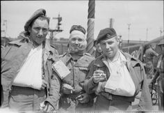 Wounded British troops, evacuated from the Normandy beaches, now back in Britain, 7 June 1944.