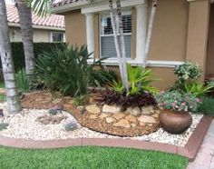 LOVING this low maintenance/low water rock gardening to complement our existing landscaping