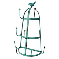 Metal rack with a distressed teal finish and bird finial. Includes 9 hooks.  Product: RackConstruction Material:
