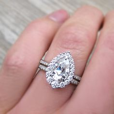 Stackable Charles & Colvard Forever One Moissanite Pear Halo Engagement Ring with Pavé Diamond Band. By Kristin Coffin Jewelry. Engagement Solitaire, Wedding Rings Solitaire, Cushion Cut Engagement Ring, Silver Engagement Rings, Bridal Rings, Halo Rings, Engagement Bands, Jewelry
