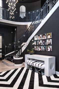 decorating with photos at the bottom of a stairway - black and white decor  | Jen Vazquez Photography | jenvazquez.com