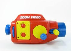 Vintage Kid Toy Video Camera. I'd like to retrofit it with an actual SD-card modern camera like a GoPro
