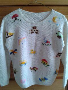 Suéter cuadros de figuras. El clásico de los nietos