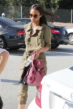 "Actress Zoe Saldana, ""Avatar"" star, is spotted leaving an office building in Los Angeles. Saldana, 33, is dressed in an olive green outfit and sunglasses as she steps in to Los Angeles streets. ."
