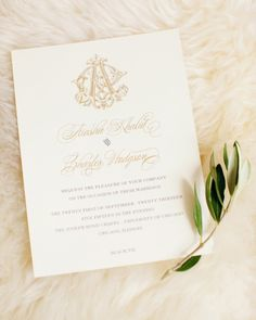 Invitations by Alexa Pulitzer were engraved in gold and charcoal gray on ecru paper. It was topped with a monogram joining the couple's first initials.