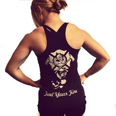 "This female firefighter fitness tank top features the female Fire and Fuel Apparel logo on the left chest. We added a female athlete hanging from the integrated F's in the image. The back has our skull and crossed nozzle logo in a center of a maltese cross. From the two crossed axes is a female firefighter athlete. As always find the things that ""Fuel Your Fire"" the burns within you!  Our Fueled To Be Fit tank top"