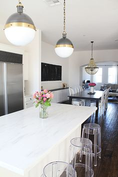 MadeByGirl: lighting above kitchen island, view towards dining room & long Ikea credenza