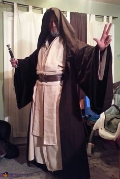 Jeremy: This is me sporting my homemade Old Ben Kenobi Costume A good friend of mine helped me make the robes and sashes, the belt was constructed from leather and all...