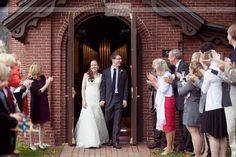 The bride and groom exit from the Old Chapel on the St. Paul's School campus in Concord, NH after their wedding ceremony in October.  #spswedding #nhfallwedding #dreamlovephotography #weddingexit