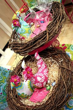 Display Idea - Why not use a wreath base as a nest and set cute items inside. Bird-themed preferably :) From the Spring Quilt Market 2010 Pillow & Maxfield