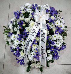 Smútočný veniec Iris  Krásny mnohokvetý okrúhly veniec z Irisov a Chryzantém . Priemer venca volitelný.  Základná cena platí pre veniec s priemerom 60 cm. Cena je vrátane doručenia v Bratislave na adresu bytovú/firemnú ako aj na cintorín, do domu smútku. V cene je smútočná stuha s textom podla Vášho želania.  #iris #smútočný #veniec #wreath #funeral #chryzantémy #živý #biele #white #fialové #purple Funeral, Iris, Bearded Iris, Irises