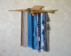 Cancer and sea  Natural tapestry made by me, represents a small red cancer in the sea, with green seaweeds, waves and its shadows then the shore in beige line, green far plains, at the top the blue night sky with some stars. The tapestry yarns are from wool and cotton. The tapestry rod is made of wood painted by light blue water color.. This woven piece has the following measurements— width: 16 cm, length from rod to yellow tassels: 42 cm. This item is complete and ready to ship. Best…