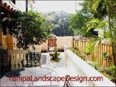 Tampa Landscape Design Mediterranean, Spanish & English style secret garden with espalier and fountain.  Lauren Shiner, Tampa Landscape Design, LLC, tampalandscapedesign.com