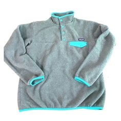 Patagonia synchilla snap t pullover Traditional women's Patagonia pullover! Gray with teal trim. Worn but no tears and lots of warmth and life left :) Patagonia Jackets & Coats