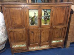 This is an antique sideboard of Asian influence and has lovely tile inserts.