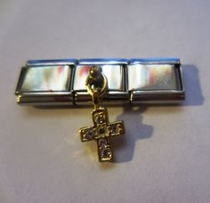 Charm Bracelet Cross Piece. $7.50, via Etsy.