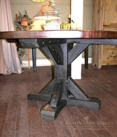 Cross buck pedestal base on a round table - This custom farm table / harvest table was designed and crafted by E. Braun Farm Tables and Furniture, Inc. using reclaimed pine barn wood - siding, flooring and beams from dismantled barns. The authentic vintage wood fits perfectly into any home. Custom design services available. Handcrafted in the heart of Amish country, Lancaster County, PA © 2015 E. Braun Farm Tables and Furniture, Inc.