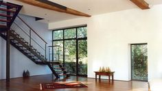 Modern wooden and black staircase | Escalier moderne en bois et acier noir