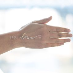 Love Gold. Part of gold temporary tattoo bracelet set by Tatty $18