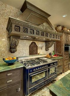 The antique iron backsplash  a special find – 18th century from France, vent hood out of various architectural elements – guaranteed uniqueness!