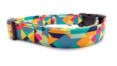This is a beautiful and colorful geometric fabric bright colors and sharp angles and shapes.  This stylish collar is made with designer cotton fabric and lined with heavy nylon webbing that has triple stitched pressure point seams for strength and durability. This adjustable collar is completed w...