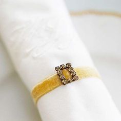 "Nice napkin ring idea: Make a ""belt"" from thin velvet ribbon and a jeweled buckle."