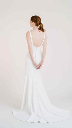 Meet Jenny Yoos  Ivette gown for Fall 2020. Classic or modern? The gorgeous Ivette is  both with her timeless boat neck silhouette offset by a chic and  unexpected open back. Featuring a boat neckline, matte crepe, soft fit  and flare silhouette, and a long chapel train skirt. The Ivette is a  timeless classic, both modest and modern with a low scoop back opening.  Perfect for a Spring, Fall or Winter wedding.