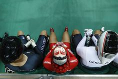 A photo shows a face painted onto the helmet of China's Zhong Tianshi as she waits with other cyclists to compete in the Keirin second round track cycling event. ODD ANDERSEN/AFP/Getty Images