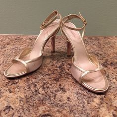 Gold heels Used, BCBG Maxazria gold, 4 in heels. Leather sole and lining and fabric upper. Size 7.5. Small mark on right shoe. Very cute! BCBGMaxAzria Shoes Heels