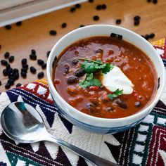 Spicy Black and Red Bean Soup Recipe - Heat the oil in a large Dutch oven over medium-high heat until hot. Add onion, carrot, and garlic; saute 5 minutes. Stir in broth, sugar, corn, beans, tomatoes, and chilies; bring to a boil. Cover, reduce heat,