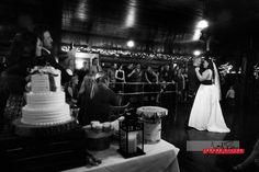 Friends and family enjoy Samantha and Corey's first dance as the newlyweds savor the moment. #wedding #idaho #priestlake #elkinsresort #idahowedding #bride #groom #reception #firstdance #blackandwhite