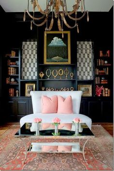 Beautiful contrast: pale #pink, dramatic #black walls, and contemporary white upholstery.