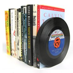 Bookends crafted from repurposed 45 rpm vinyl records. - I am trying to figure out what to do with some old records