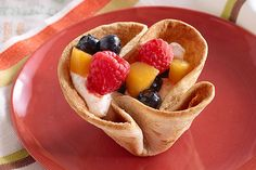 Fresh peaches, raspberries and blueberries get a lovely presentation on a cloud of COOL WHIP nestled inside a crisp tortilla.