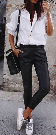 #spring #outfits woman wearing white dress shirt with black slim pants and pair of low-top sneakers outfit. Pic by @london_style_calling