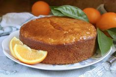 Sicilian Whole Orange cake on a plate with oranges Food Cakes, Cupcake Cakes, Cupcakes, Sweets Recipes, Just Desserts, Baking Recipes, Fun Recipes, Whole Orange Cake, Orange Cakes