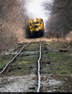 This is not a derailment. The crew has stopped the train to check and see if any of their cars are on the ground. It's a real train on a real, if somewhat (ahem) ridiculous, track. The crew resumed their trip shortly thereafter. Location is Defiance, Ohio.