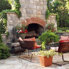 Vines and container gardens surround this grand fireplace making it feel soft and welcoming. More outdoor fireplaces: http://www.bhg.com/home-improvement/porch/outdoor-rooms/fabulous-outdoor-fireplaces/?socsrc=bhgpin070513softstone=2