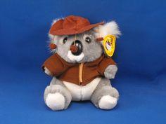 New product 'Jimmys Soft Toys Small SWAGGIE Koala Plush Australia Souvenir' added to Dirty Butter Plush Animal Shoppe! - $6.00 - Jimmy's Soft Toys Plush 8 inch Seated SWAGGIE Gray Koala Bear Australia Souvenir - White Fur Ears, Eyelashes, Whiske…