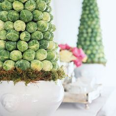 Easy Easter Centerpieces and Table Settings Finally a good use for Brussels sprouts.) TopiariesFinally a good use for Brussels sprouts. Easter Table Settings, Easter Table Decorations, Decoration Table, Easter Centerpiece, Summer Centerpieces, Topiary Centerpieces, Centerpiece Ideas, Diy Osterschmuck, Diy Crafts