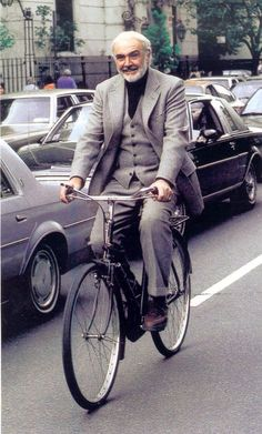Sean Connery rides a bike.