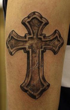 cracking cross   cross tattoos