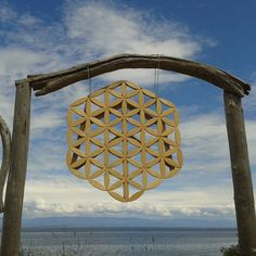 I started woodworking making garden trellises. On my way to my friends wedding my best trellis snapped from the wind in the roof of our car. I was taking it to display since the groom was very much into the flower of life. I ended up hanging it in this arch instead at the ceremony. That's how I started making mandalas. Funny how things progress. #woodwork #woodart #woodmagic #wallhanging #woodmandala #woodmandala #vancouverisland #cedar #customwood #cumberlandbc #floweroflife #sacredgeometry…